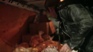 Man loading up food in packed van