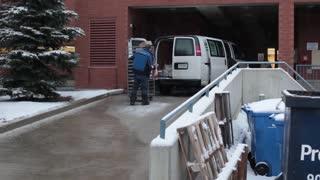 Men loading food into back of van