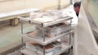 Men re-organizing food in van