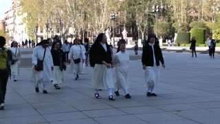 Nuns walking by Royal Palace of Madrid, Spain