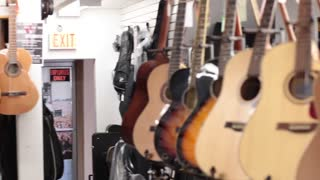Pan acoustic guitars on wall