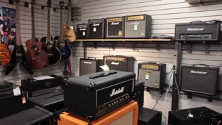 Pan guitar amps in music store