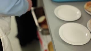 Person preparing bread on plates