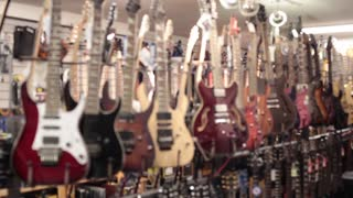 Rack focus row of electric guitars