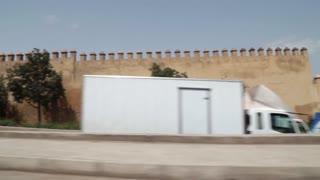 shot from taxi outside medina walls fez morocco