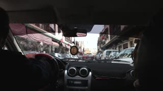 Shot of taxi driver from back seat. Fez Morocco