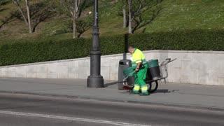 Spain garbage man picking up litter
