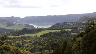 Static shot wide lake and lush forest valley Sao Miguel Azores