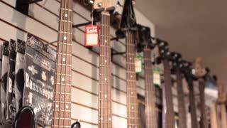 Tilt down row of bass guitars