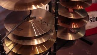 Tilt up multiple cymbals