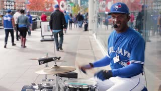 Toronto blue jays street performer drummer medium shot