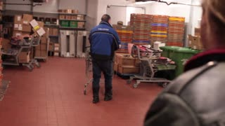 Two men in grocery store back room