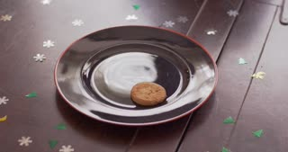 A single cookie is bitten and put back on the plate.