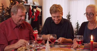 Family setting up card game to play at holiday dinner table for Christmas