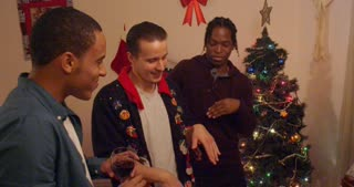 Group of guys try to impress the ladies at holiday party with their dance moves.