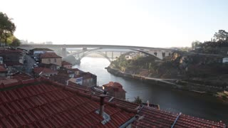 View of bridge Porto Portugal landscape early morning empty rooftop roof houses