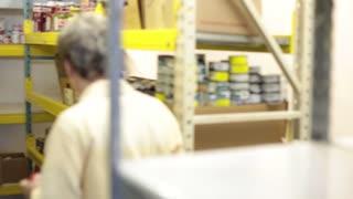 Volunteer organizing non-perishable goods
