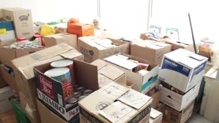 Volunteers sorting through donated non-perishable goods