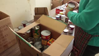 Volunteers sorting through donated non-perishable goods