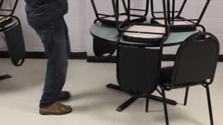 Volunteers stacking chairs