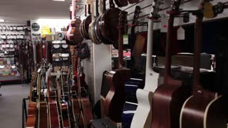 Wide shot pan acoustic guitars