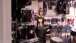 Wide shot pan drum room in music store