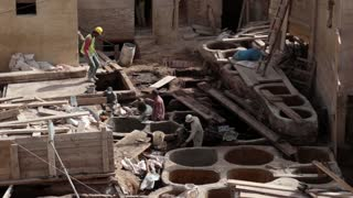 Workers in construction for tanneries tannery in Morocco v3
