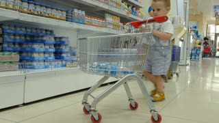 A little baby boy with his mother are shopping