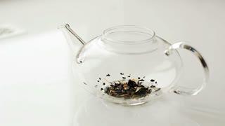 Brew tea in a glass tea pot.