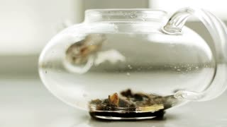 Brew tea in a glass tea pot