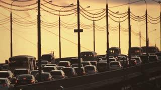 Car traffic jam on the bridge Kanavinsky over Oka river at sunset.