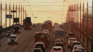 Car traffic jam on the bridge Kanavinsky over Oka river on sunset