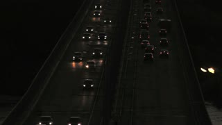 Car traffic on evening bridge