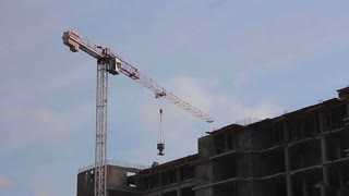 Cranes working on construction site.