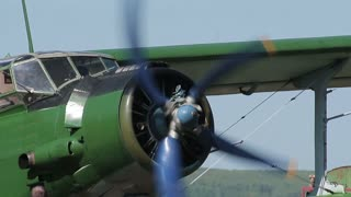 Old airplane starts his engine.