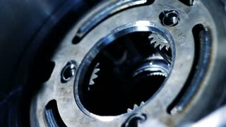 Rotating of metal parts in a mechanical device. Spinning mechanism of car engine