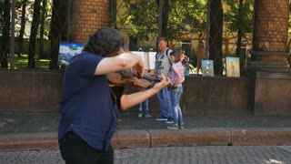 street musician playing on violin