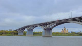The barge passes under the bridge Kanavinsky over Oka river
