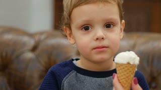 Little baby eating ice-cream