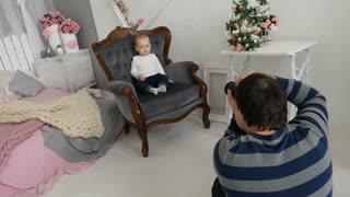 Photoshoot baby boy in sunny room