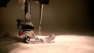 sewing machine sewing of clothes close up