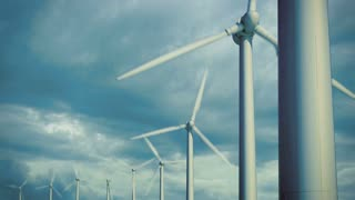 Wind turbines at sky background