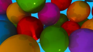 A group of balloons with the words Happy Birthday hanging from the strings in multicolored shades