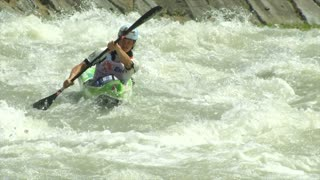 A kayaker paddling (in slow motion) through rapids during the ICF Wildwater Canoeing World Championships, 11 June 2014 on River Adda in Valtellina (Italy)