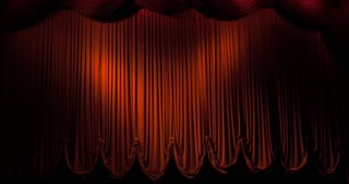 A red curtain stage opening and fading to black