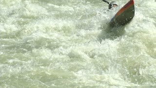 A woman participates in the ICF Wildwater Canoeing World Championships, 11 June 2014 on River Adda in Valtellina (Italy)