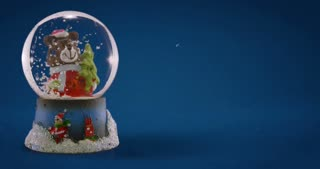 Christmas snow globe with little bear on light blue background