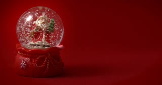 Christmas snow globe with Santa Claus on red background