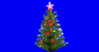 Christmas tree on blue screen background, rotating loop