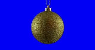 Gold Christmas ball isolated on blue screen background, rotating loop